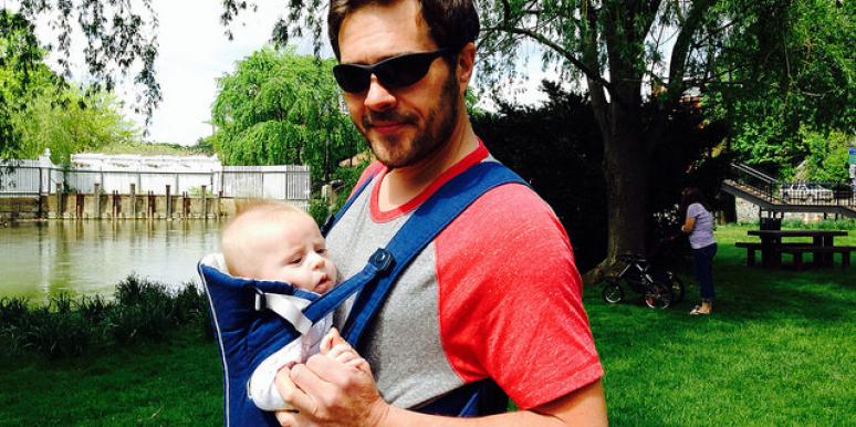 Serge Bielanko holding baby