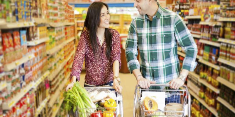 Two people flirting at supermarket.