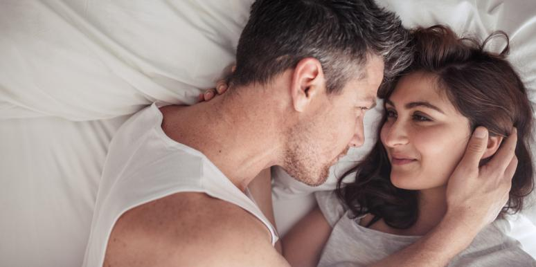 man and woman in bed listening to songs about sex