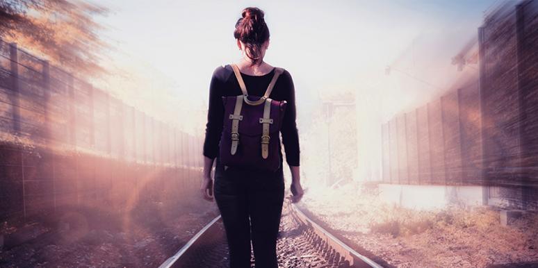 woman walking on train tracks