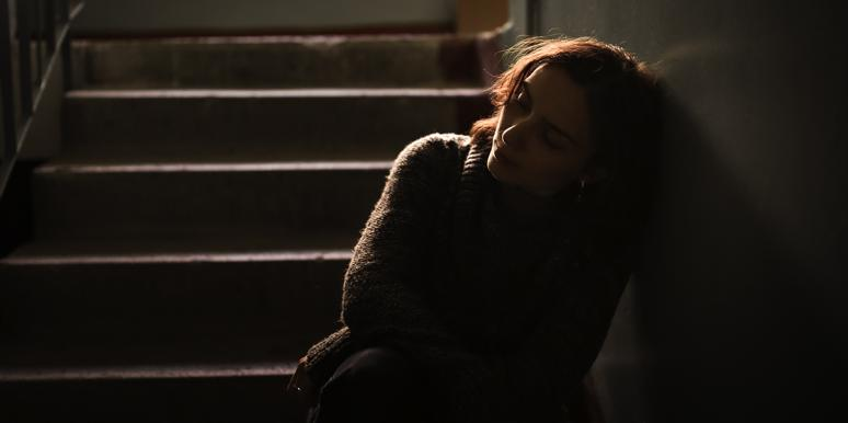 sad woman sitting in the dark