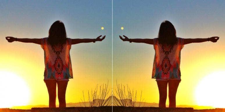 woman worshipping the sun