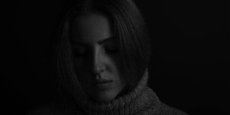 serious woman in dark