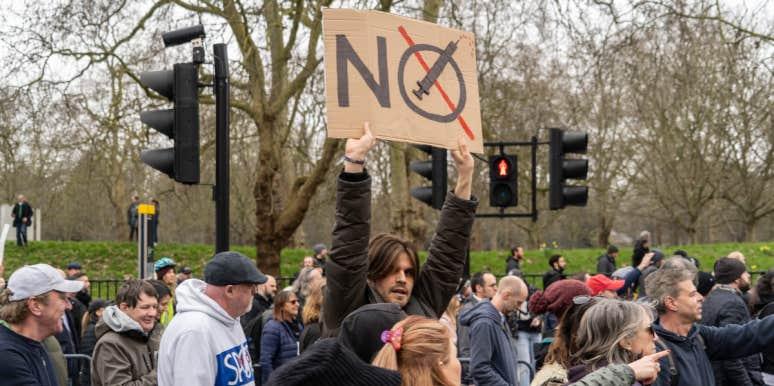 anti vax man holding sign