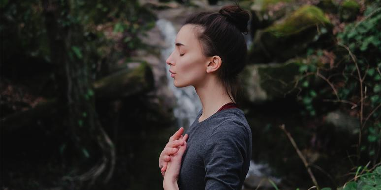 woman doing breathing technique