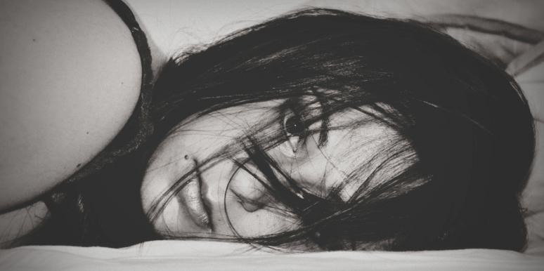 black and white photo of woman lying down