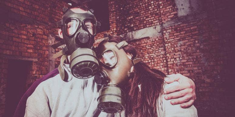 couple wearing gas masks
