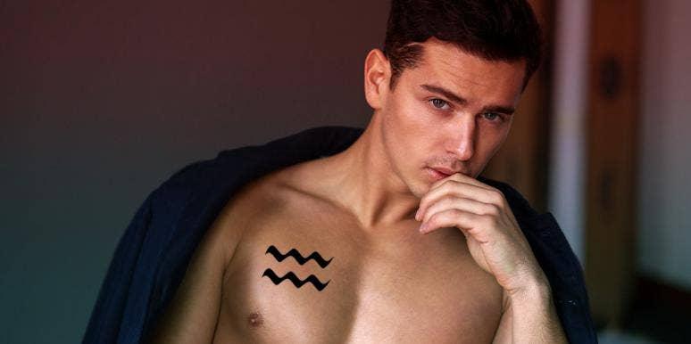 man with aquarius tattoo on chest