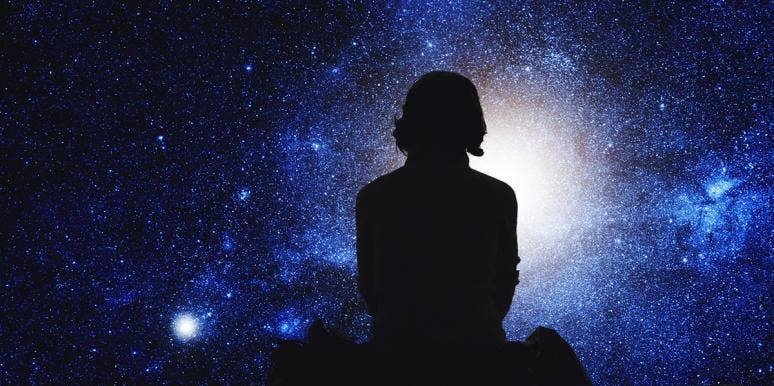 woman sitting watching stars