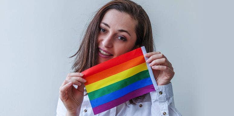 woman with lgbtq pride flag