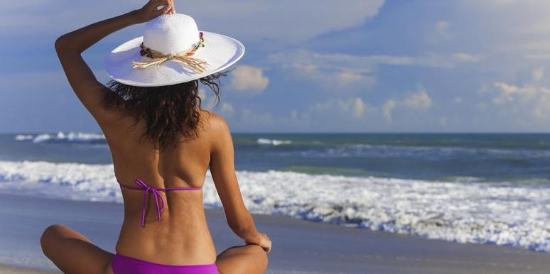 woman on the beach with back dimples