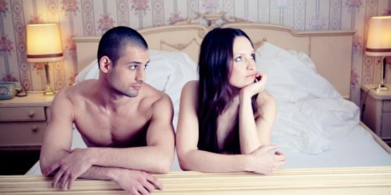 couple in bed looking away