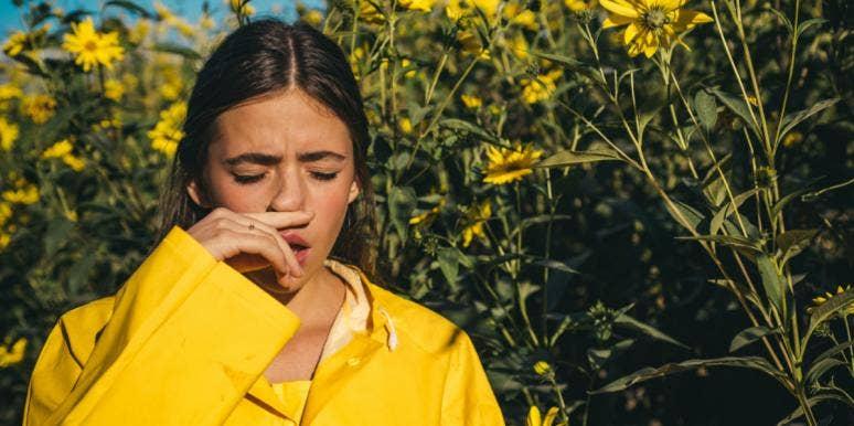 woman in field of flowers with seasonal allergies
