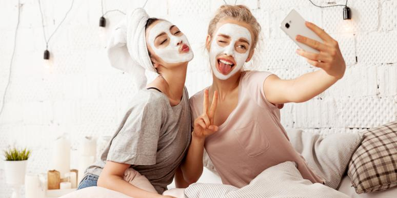 women with face masks on taking a selfie