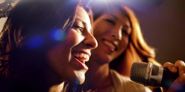 women lip syncing