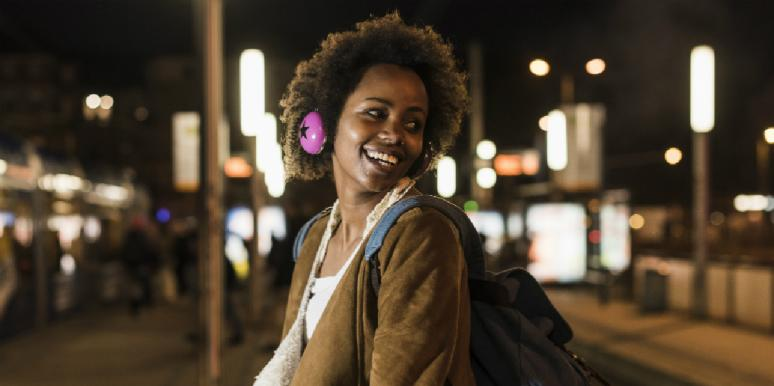 woman listening to songs about moving on