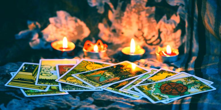 tarot cards surrounded by candles