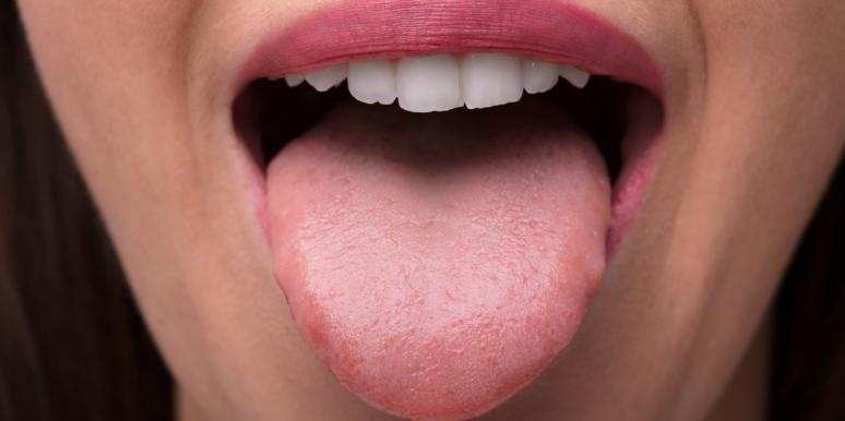 closeup of woman's mouth with her tongue out