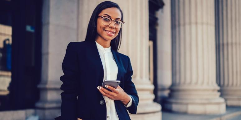 professional woman holding smartphone