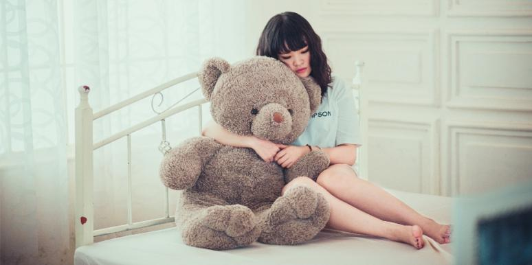 Girl hugging stuffed bear