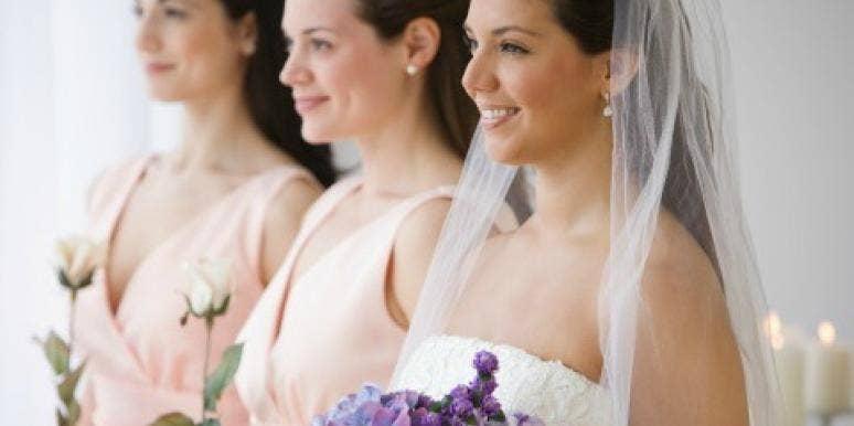 bride and bridesmaids waiting at the altar