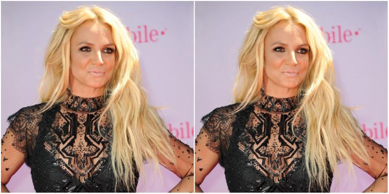 Britney Spears posing in black lace dress on step & repeat
