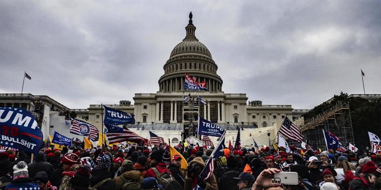 Capitol building surrounded by Trump mob