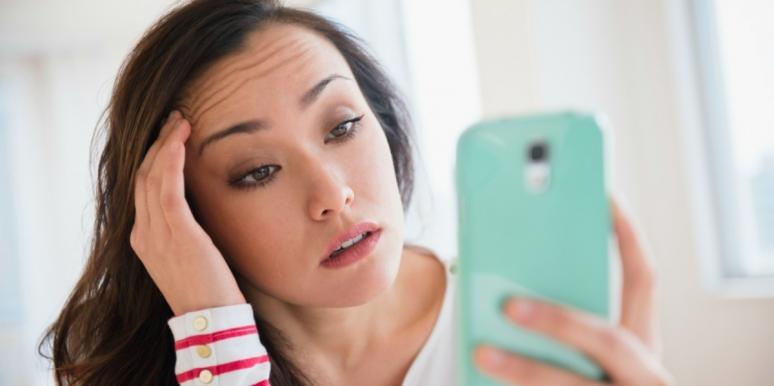 stressed-out woman looking at phone