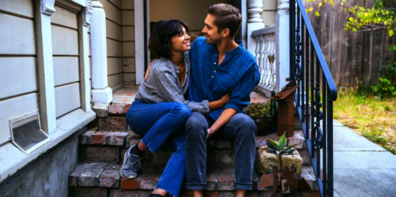 man and woman on stoop