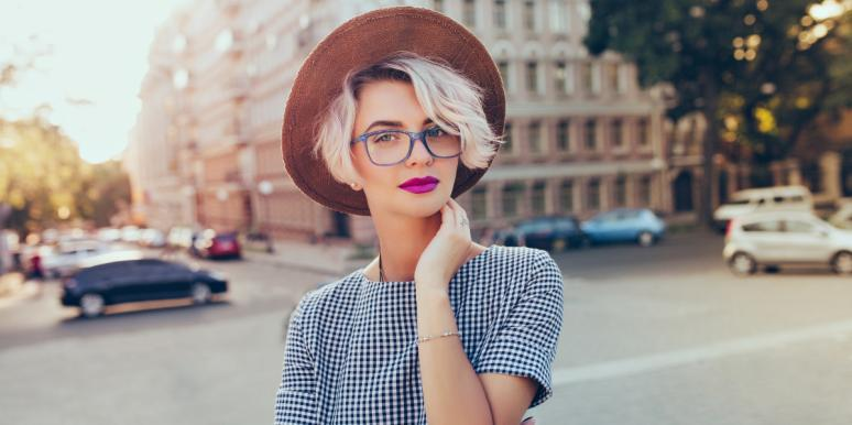 woman with short hair in a hat