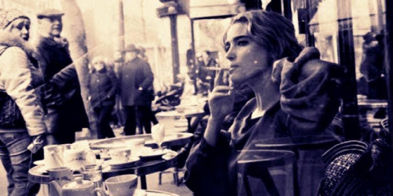woman sitting and smoking outside