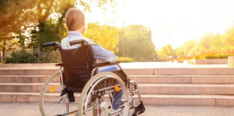 woman in a wheelchair outside