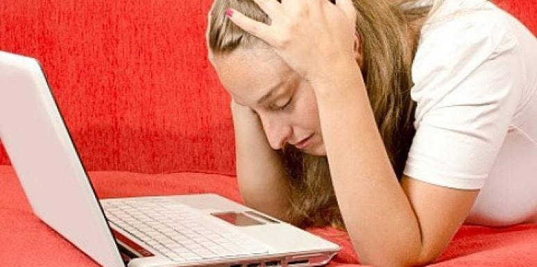 woman upset at computer