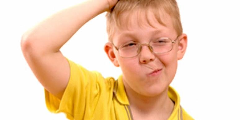 confused child scratching top of head