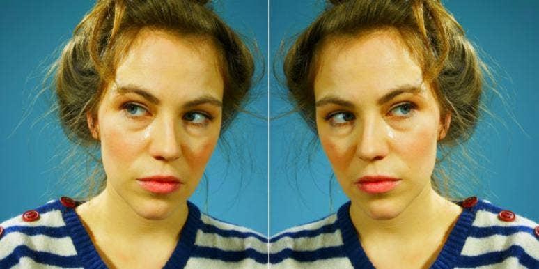 stern woman striped shirt blue background