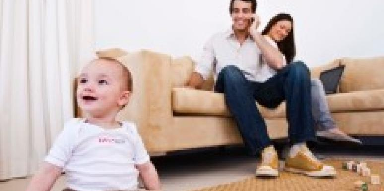 couple watching their baby from the couch