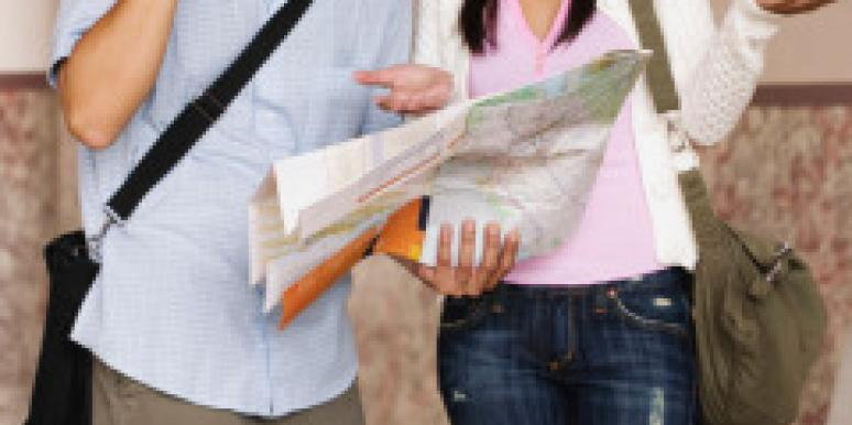 lost asian couple with map argues about directions