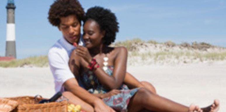 couple beach lighthouse picnic