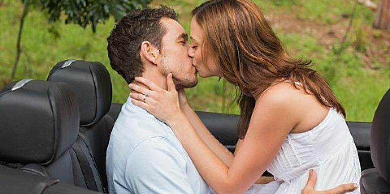 couple kissing in convertible