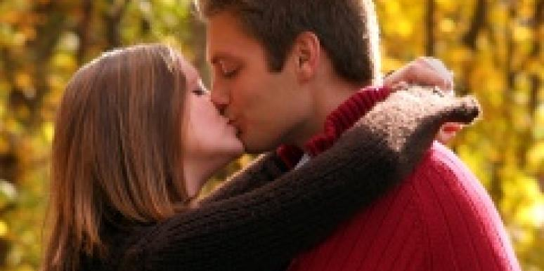 Couple Kissing in the Fall