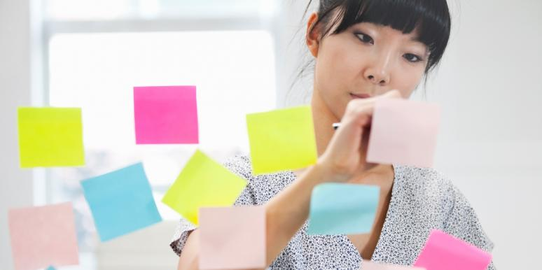 woman writing on post its