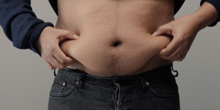 man holding belly fat