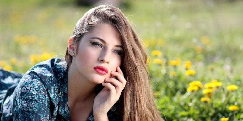 Girl sitting in grass
