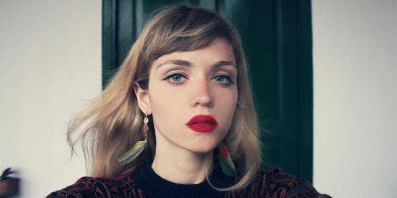 solemn woman wearing red lipstick