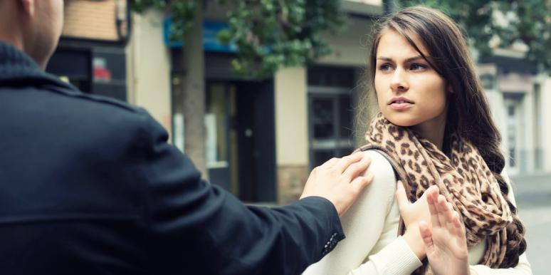 upset woman backing away from man