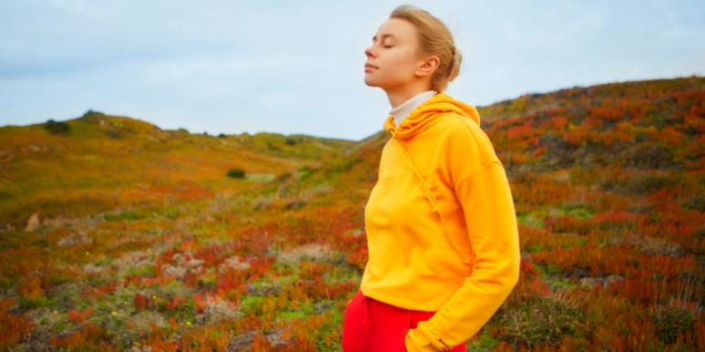 relaxed woman with eyes closed in nature