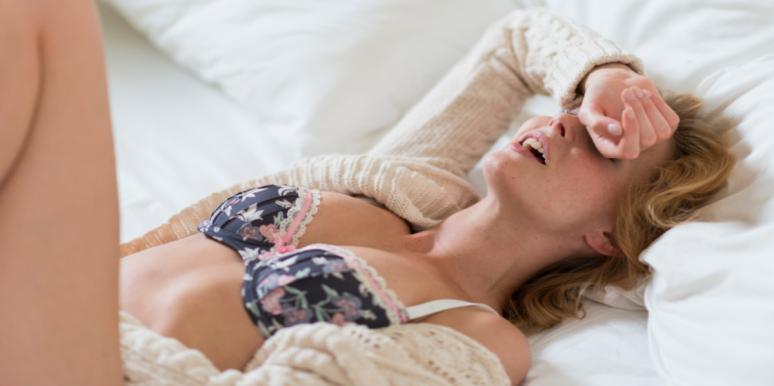 woman in lingerie laying in bed