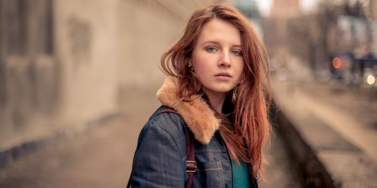red haired woman looking at the camera