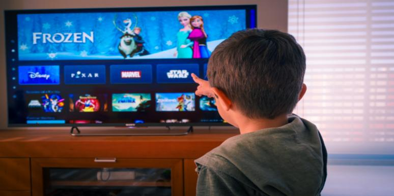 boy pointing to Disney's Frozen on the TV