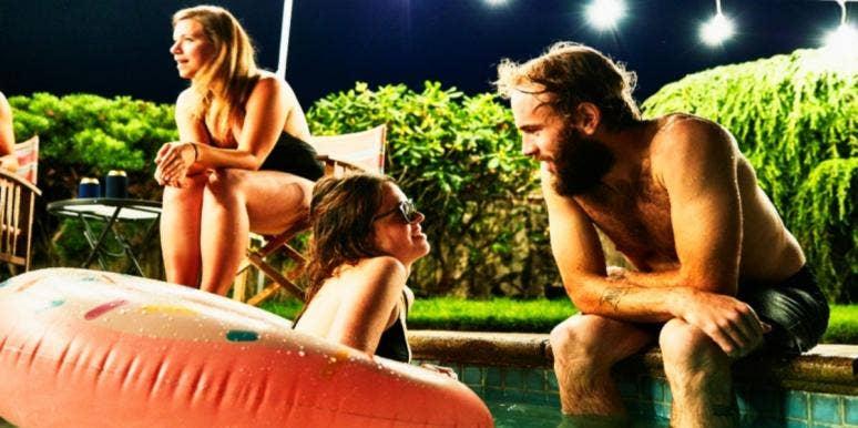 couple in pool talking